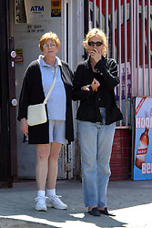 ! Passers-by stared in disbelief as 'Pretty Woman' JULIA ROBERTS and her mother BETTY LOU ROBERTS spent an afternoon window shopping in the Venice Beach neighborhood where the actress recently bought a home with husband Danny Moder. Julia, looking tired and drawn, gently held the hand of her mother, who turns 69 in two weeks. They went into several clothing boutiques and an art supply store, but left without buying anything. (Credit Image: © Mike Carrillo/ZUMAPRESS.com)