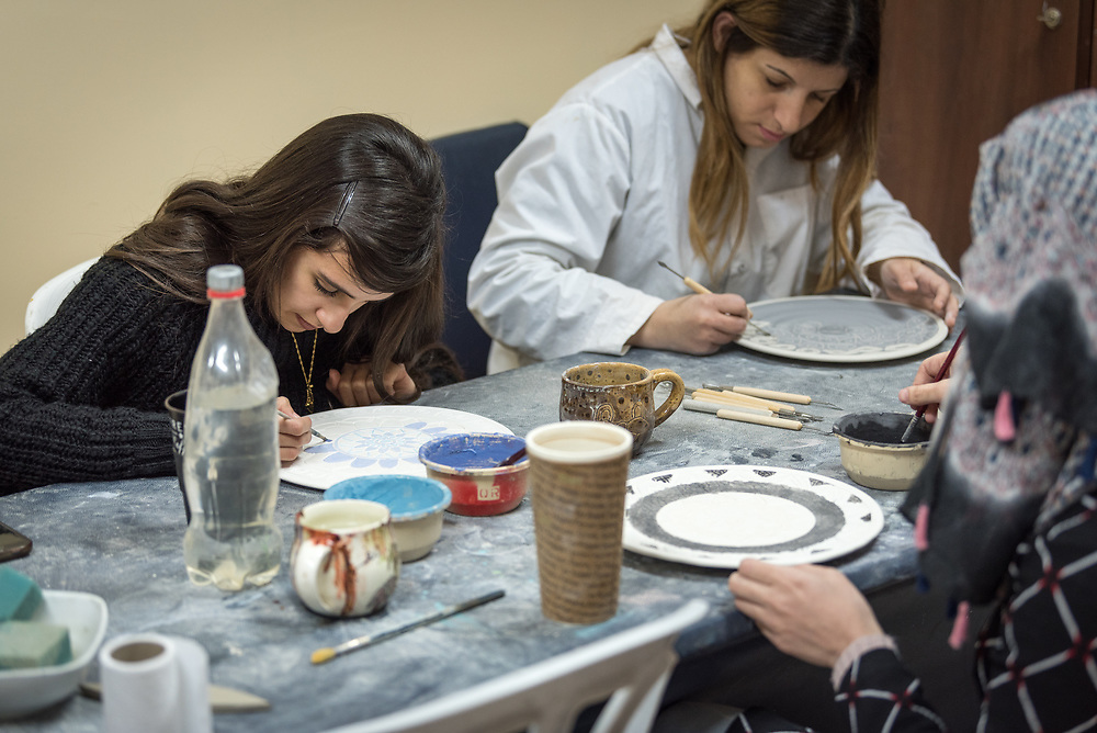25 February 2020, Jerusalem: Students Asil Shehadeh (left) and deaf student Shireen ABu-Elhawa (right) work on a design in ceramics class. The Lutheran World Federation's vocational training centre in Beit Hanina offers vocational training for Palestinian youth across a range of different professions, providing them with the tools needed to improve their chances of finding work.