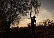 Cheyenne Johnson, 21, hula hoops at Seneca Lake State Park in Geneva, NY, Thursday, May 14, and Sunday, May 17, 2015.<br /> (Heather Ainsworth for The Syracuse Post-Standard)