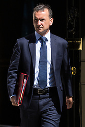 London, UK. 16 July, 2019. Alun Cairns MP, Secretary of State for Wales, leaves 10 Downing Street following a Cabinet meeting.