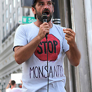"""Richard Hillwig speaks on the steps of city hall in downtown Orlando, Florida on Saturday, May 5, 2013. Activists gathered to support a global protest named  """"March Against Monsanto,"""" demanding a stop to the use of agrochemicals and the production of genetically modified food, which according to them has harmful health effects, causing cancer, infertility and other diseases. Marches and rallies against seed giant Monsanto were held across the U.S. and in dozens of other countries. (AP Photo/Alex Menendez)"""