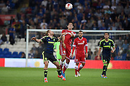 Peter Whittingham of Cardiff city © heads the ball. Skybet football league championship match, Cardiff city v Middlesbrough at the Cardiff city stadium in Cardiff, South Wales on Tuesday 16th Sept 2014<br /> pic by Andrew Orchard, Andrew Orchard sports photography.