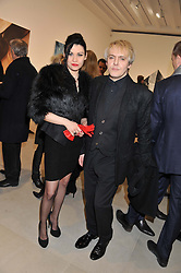 NICK RHODES and NEFER SUVIO at a private view of work by Mat Collishaw - 'This is Not an Exit' held at Blaine/Southern, 4 Hanover Square, London on 13th February 2013.