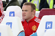 Wayne Rooney, the Manchester United captain looks on from the bench before k/o. The Emirates FA cup, 6th round replay match, West Ham Utd v Manchester Utd at the Boleyn Ground, Upton Park  in London on Wednesday 13th April 2016.<br /> pic by John Patrick Fletcher, Andrew Orchard sports photography.