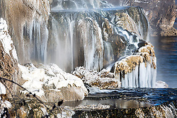 Waterfall in winter, Swan Valley Idaho.  Fall Creek Falls dumps from Fall Creek into the Snake River.