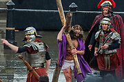 Jesus is sent for Crucifixion and has to carry his cross through the crowd - The Wintershall Players open-air re-enactment of 'The Passion of Jesus' on Good Friday in the rain in Trafalgar Square. It featured a cast of over 100 volunteers from in and around London.