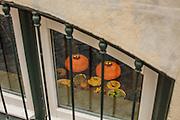 "The breakfast table of hotel ""Casa das Janelas com Vista"" seen through one of the windows at street level."