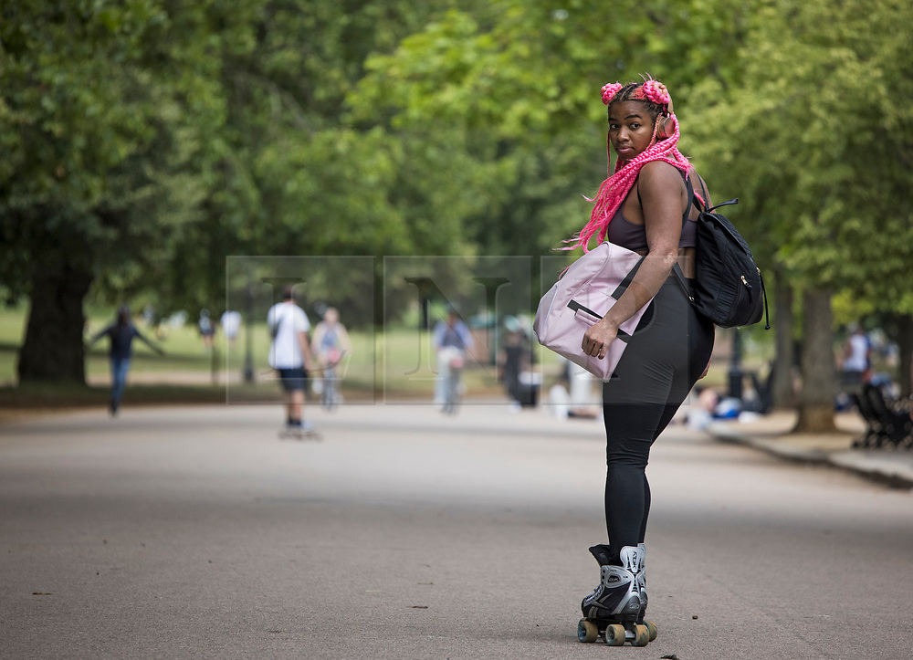 © Licensed to London News Pictures. 09/07/2021. A woman on roller-skates in Hyde Park, central London on a summer's day. Wet and warm conditions are expected over the weekend. Photo credit: Ben Cawthra/LNP