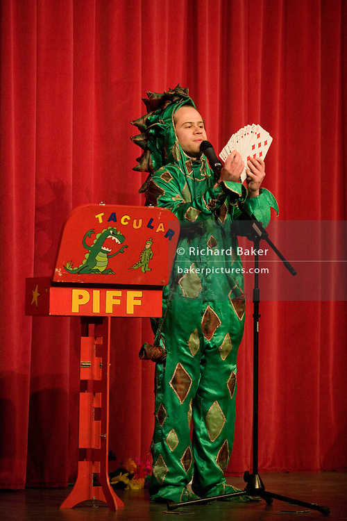 The magic act Piff the magic Dragon performs on stage in London.