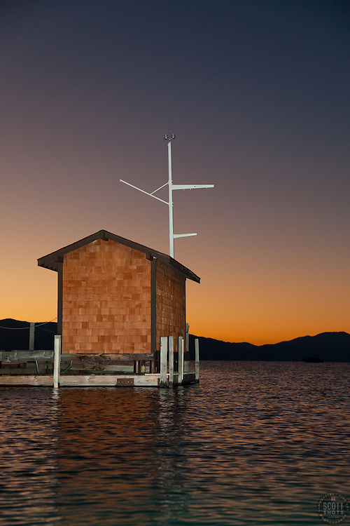 """""""Tahoe City Pier at Sunrise 3"""" - This small building on the end of a pier was photographed at sunrise near Commons Beach, Lake Tahoe. Photographed from a kayak."""