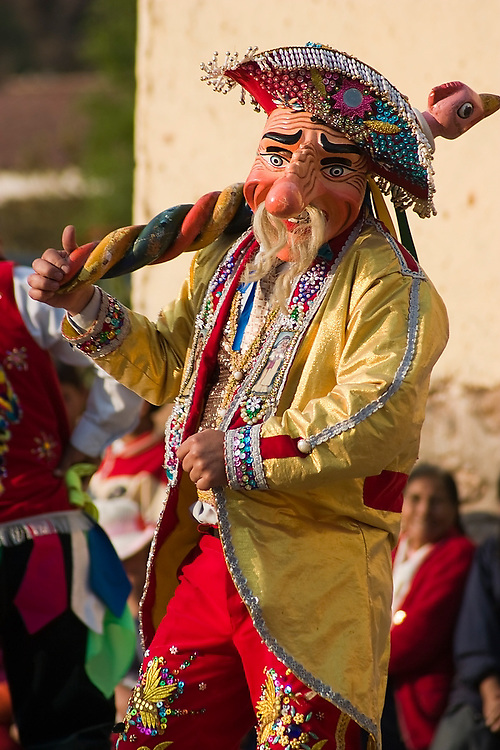 A masked dancer performs in a dance competition held in Llamay, Sacred Valley, Peru on September 1, 2005. The festival is held in honor of Santa Rosa de Lima, South America's first catholic saint.