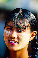 Burmese woman with thanaka bark makeup outside Shwe Nandaw Kyaung Monastery, Mandalay, Burma (Myanmar)