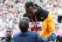 London, 2017 August 06. Men's 100m bronze medalist Usain Bolt is presented his medal by Lord Sebastian Coe at  the medal ceremony on day three of the IAAF London 2017 world Championships at the London Stadium. © Paul Davey.
