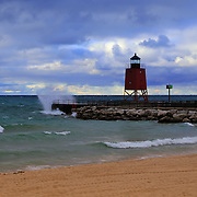 """""""Charlevoix Lighthouse Storm"""" 2<br /> <br />  The beautiful red lighthouse in Charlevoix Michigan during a storm with waves breaking against the pier!!<br /> <br /> Lighthouses of the Great Lakes by Rachel Cohen"""