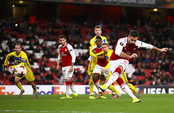Arsenal's Olivier Giroud scores his side's fifth goal of the game from the penalty spot