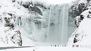 Frozen Skógafoss waterfall, south Iceland