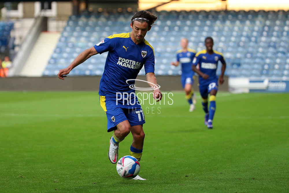AFC Wimbledon midfielder Ethan Chislett (11) dribbling  during the EFL Trophy Group O match between AFC Wimbledon and Charlton Athletic at the Kiyan Prince Foundation Stadium, London, England on 1 September 2020.