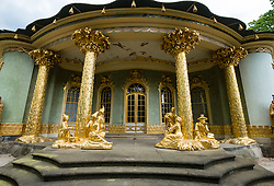 Golden statues decorate Chinese Teahouse in Sanssoucci park in Potsdam, Brandenburg, Germany