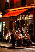 Dining outdoors at Cafe Constant on Rue St. Dominique, Paris, France.