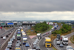 © Licensed to London News Pictures. 23/08/2018<br /> Dartford, UK.<br /> August Bank holiday getaway traffic chaos on the M25,Dartford.<br /> Anti clock-wise queues this afternoon with dark clouds over head.<br /> Photo credit: Grant Falvey/LNP