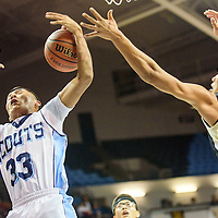 012915  Adron Gardner/Independent<br /> <br /> Window Rock Scout Myron Wauneka (33), left, and Chinle Wildcat Sooner Brady (32) reach for a rebound at the Stronghold Event Center in Fort Defiance Thursday.
