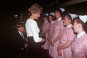 Accompanied by sons William and Harry, Diana Princess of Wales meets nursing staff during a visit to Great Ormond Street Hospital for Children on 5th April 1992 in London, England. Great Ormond Street Hospital is a children's hospital located in the Bloomsbury area of the London Borough of Camden, and a part of Great Ormond Street Hospital for Children NHS Foundation Trust.