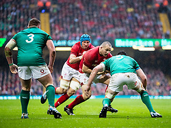 Ken Owens of Wales under pressure from James Ryan of Ireland<br /> <br /> Photographer Simon King/Replay Images<br /> <br /> Six Nations Round 5 - Wales v Ireland - Saturday 16th March 2019 - Principality Stadium - Cardiff<br /> <br /> World Copyright © Replay Images . All rights reserved. info@replayimages.co.uk - http://replayimages.co.uk