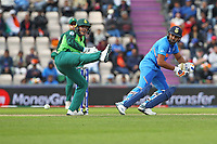 Cricket - 2019 ICC Cricket World Cup - Group Stage: South Africa vs. India<br /> <br /> Rohit Sharma of India flicks the ball round Quinton de Kock of South Africa to pick up another single at the Hampshire Bowl Southampton England<br /> <br /> COLORSPORT/SHAUN BOGGUST