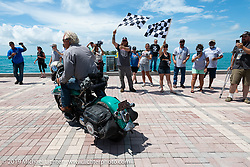 Bob Gamache of Lakeville, MA riding his 1948 Harley-Davidson FL Panhead over the finish line of the Cross Country Chase motorcycle endurance run from Sault Sainte Marie, MI to Key West, FL. (for vintage bikes from 1930-1948). The Grand Finish in Key West's Mallory Square after the 110 mile Stage-10 ride from Miami to Key West, FL and after covering 2,368 miles of the Cross Country Chase. Sunday, September 15, 2019. Photography ©2019 Michael Lichter.
