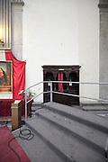 stage in church blocking a confessional, Duomo, Città di Castello, Umbria, Italy