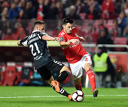 LISBON, Feb. 11, 2019  Pizzi (R) of Benfica vies with Sergio Marakis of Nacional during the Portuguese League soccer match between SL Benfica and CD Nacional at Luz stadium in Lisbon, Portugal, on Feb. 10, 2019. Benfica won 10-0. (Credit Image: © Xinhua via ZUMA Wire)
