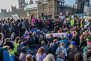 Westminster Bridge is the first blocked - Extinction Rebellion Day -  co hosted by Rising Up, 'Rebel Against the British Government For Criminal Inaction in the Face of Climate Change Catastrophe and Ecological Collapse'. A protest that involves blocking 5 bridges: Southwark, Blackfriars, Waterloo, Westminster and Lambeth.