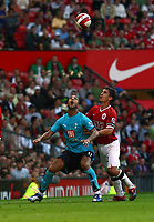Mido is challenged by Man United's Gary Neville<br />Tottenham Hotspur 2006/07<br />Manchester United V Tottenham Hotspur 09/09/06<br />The Premier League<br />Photo Robin Parker Fotosports International