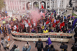 © Licensed to London News Pictures. 01/05/2021. London, UK. Protesters walk along The Mall in central London during a May Day Kill the Bill demonstration. The Police, Crime, Sentencing and Courts Bill proposes new restrictions on protests. Photo credit: Peter Macdiarmid/LNP