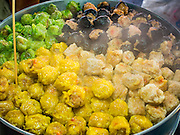 """23 DECEMBER 2015 - BANGKOK, THAILAND: Steamed dumplings, called """"shumai"""" for sale at a street stand in Banglamphu Market in Bangkok. The dumplings are a Thai version of Chinese dim sum. Banglamphu Market (also spelled Bang Lamphu) is close to Bangkok's backpacker haunts of Khao San Road. The market is a popular place for knock off designer clothes and street food. The market is an informal collection of street stalls and sidewalk vendors. Bangkok city officials have plans to evict the vendors, close the market and gentrify the neighborhood. This would follow closing similar markets on Maharat Road and Saphan Lek.       PHOTO BY JACK KURTZ"""