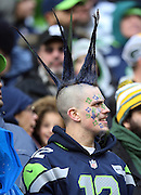 A Seattle Seahawks fan sports team colored spiked hair with the number 12 painted all over his face during the Seattle Seahawks NFL week 20 NFC Championship football game against the Green Bay Packers on Sunday, Jan. 18, 2015 in Seattle. The Seahawks won the game 28-22 in overtime. ©Paul Anthony Spinelli