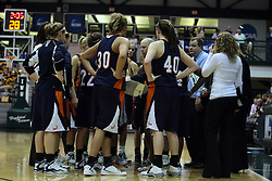 19 March 2010: The Flying Dutch surround Coach Brian Morehouse during a time out. The Flying Dutch of Hope College defeat the Yellowjackets of the University of Rochester in the semi-final round of the Division 3 Women's Basketball Championship by a score of 86-75 at the Shirk Center at Illinois Wesleyan in Bloomington Illinois.