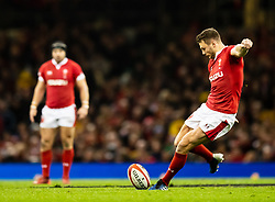 Dan Biggar of Wales kicks at goal<br /> <br /> Photographer Simon King/Replay Images<br /> <br /> Six Nations Round 1 - Wales v Italy - Saturday 1st February 2020 - Principality Stadium - Cardiff<br /> <br /> World Copyright © Replay Images . All rights reserved. info@replayimages.co.uk - http://replayimages.co.uk