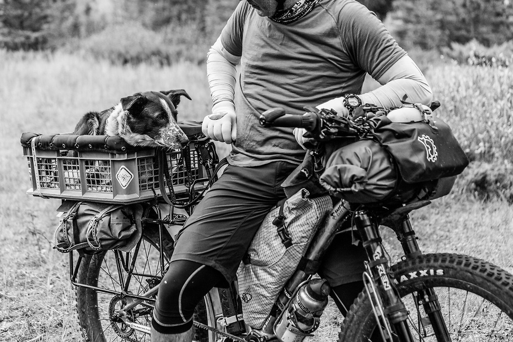 Mira and John Freeman biking at Quarry Lake Dog Park in Canmore, Alberta