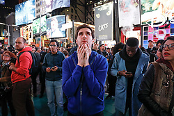 © Licensed to London News Pictures. 09/11/2016. New York City, USA. A man holds his head in his hands as he  react to news that Donald Trump looks likely to be elected as the next president of the United States, while gathering in Times Square, New York City, on Wednesday, 9 November. Photo credit: Tolga Akmen/LNP