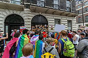 """People organised by the """"Polish Rainbow UK"""" gathered in front of the Polish Embassy in central London on Saturday, Aug 15, 2020 - to protest the latest Polish government crackdown on Polish LGBTQ activists. The arrest of a non-binary person on Aug. 7 underscores the growing crackdown against LGBTQ activists in Poland. Margot Szutowicz, who uses female pronouns, and nearly 50 others were arrested in Warsaw, the country's capital, while protesting Szutowicz's imminent arrest for allegedly causing damage to a truck promoting anti-LGBTQ messages and assaulting a pro-life demonstrator on June 2. (VXP Photo/ Vudi Xhymshiti)"""