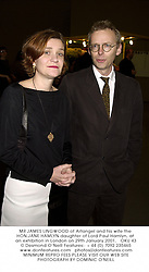 MR JAMES LINGWOOD of Artangel and his wife the HON.JANE HAMLYN daughter of Lord Paul Hamlyn, at an exhibition in London on 29th January 2001.OKU 43