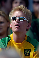 Photo: Jed Wee/Sportsbeat Images.<br /> Hull City v Norwich City. Coca Cola Championship. 25/08/2007.<br /> <br /> A Norwich fan enjoys the sunshine at the KC Stadium.