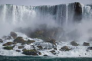 SHOT 10/21/17 1:17:42 PM - Seagulls fly around the American Falls in Niagara Falls, N.Y. The American Falls is the second-largest of the three waterfalls that together are known as Niagara Falls on the Niagara River along the Canada–U.S. border. Unlike the much larger Horseshoe Falls, of which two-thirds is located in Ontario, Canada and one-third in the U.S. state of New York, the American Falls is entirely within the United States. Located on the Niagara River, which drains Lake Erie into Lake Ontario, the combined falls form the highest flow rate of any waterfall in North America that has a vertical drop of more than 165 feet (50 m). During peak daytime tourist hours, more than six million cubic feet of water goes over the crest of the falls every minute. Horseshoe Falls is the most powerful waterfall in North America, as measured by flow rate. Niagara Falls is famed both for its beauty and as a valuable source of hydroelectric power. The falls are 17 miles (27 km) north-northwest of Buffalo, New York. Buffalo, N.Y. is the second most populous city in the state of New York and is located in Western New York on the eastern shores of Lake Erie and at the head of the Niagara River. By 1900, Buffalo was the 8th largest city in the country, and went on to become a major railroad hub, the largest grain-milling center in the country and the home of the largest steel-making operation in the world. The latter part of the 20th Century saw a reversal of fortunes: by the year 1990 the city had fallen back below its 1900 population levels. (Photo by Marc Piscotty / © 2017)