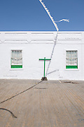 White bunting adorned every street, and the tiny white flags buzzed in the strong Atlantic breeze blowing over the Canary Islands. In the hot streets the cooling effect of the wind was extremely welcome