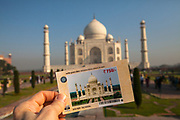 Entrance ticket in front of the Taj Mahal. It is an ivory-white marble mausoleum on the southern bank of the river Yamuna in the Indian city of Agra