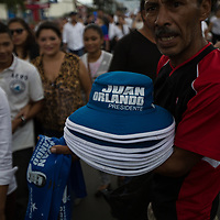 Hats printed with Juan Orlando for president weren't bought in large numbers.
