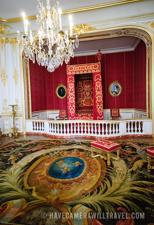 The ornately decorated royal bedroom of King Louis XIV at the Chateau de Chambord, one of the largest of the chateaux in the Loire Valley, France.