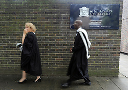 © licensed to London News Pictures. LONDON, UK.  09/09/11. Teaching staff walk past the school sign. London Mayor Boris Johnson joins Chair of Governors Toby Young to officially open the The West London Free School (WLFS). The WLFS is an 11-18 secondary school, which has been set up by a group of parents and teachers in Hammersmith. The school is led by headmaster Thomas Packer . Mandatory Credit Stephen Simpson/LNP