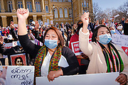 06 MARCH 2021 - DES MOINES, IOWA: Members of Iowa's Burmese community chant against the Burmese military during a protest against the coup in Myanmar. About 300 members of the Burmese community in Iowa gathered at the State Capitol in Des Moines Saturday to protest against the military coup that deposed the popularly elected government of Aung San Suu Kyi and continuing military oppression in Myanmar. There are about 10,000 people in Iowa's Burmese community.         PHOTO BY JACK KURTZ